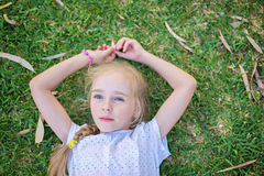 Caucasian little girl lay on grass Royalty Free Stock Image