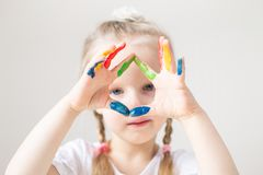 Caucasian Little Girl Painting with Colorful Hands Paints at Home Early Education. Preparing for School Preschool Development Children Game stock image