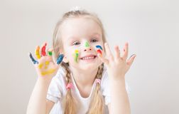 Caucasian Little Girl Painting with Colorful Hands Paints at Home Early Education. Preparing for School Preschool Development Children Game royalty free stock images