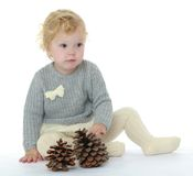 Caucasian little girl playing with pine cones Stock Photography