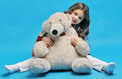 Caucasian little girl with a polar bear Stock Image