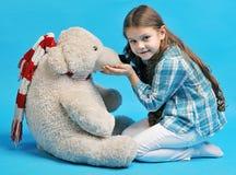 Caucasian little girl with a polar bear Royalty Free Stock Photos