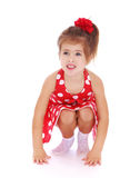 Caucasian little girl squatted down and looking at Royalty Free Stock Images