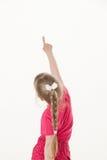 Caucasian little girl turning back and indicating something up Stock Photography