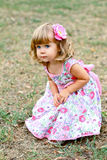 Caucasian little girl walking in the park Royalty Free Stock Photography