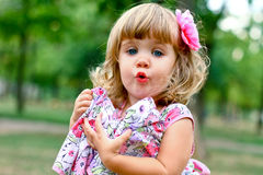 Caucasian little girl walking in the park Royalty Free Stock Images