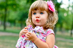 Caucasian little girl walking in the park Royalty Free Stock Image