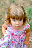Caucasian little girl walking in the park Stock Images