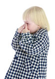 Caucasian little girl wipes her tears fingers Royalty Free Stock Photography