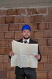 Caucasian Male Construction Manager With Blueprint Royalty Free Stock Photography