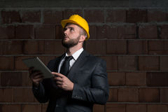 Caucasian Male Construction Manager With Tablet Pc Stock Image