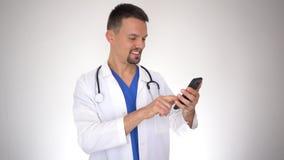 Caucasian male doctor using smartphone
