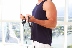 Caucasian male doing resistance training indoors Stock Image