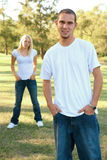 Caucasian Male And Female Standing Outdoor In Park Royalty Free Stock Photography