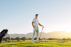 Caucasian male golfer standing on golf course Stock Photos