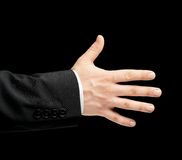 Caucasian male hand in a business suit isolated. Caucasian male hand in a business suit, opened five fingers palm gesture sign, low-key lighting composition stock photo