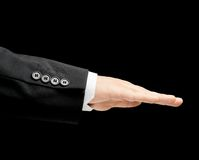 Caucasian male hand in a business suit isolated. Caucasian male hand in a business suit with a opened palm gesture sign, low-key lighting composition, isolated stock photos