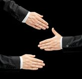 Caucasian male hand in a business suit isolated. Caucasian male hand in a business suit, opened palm gesture sign offering a handshake in three versions, low-key royalty free stock images