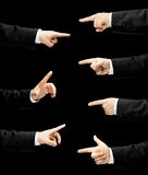 Caucasian male hand in a business suit isolated. Caucasian male hand in a business suit, pointing with an index finger gesture sign, low-key lighting composition royalty free stock photos