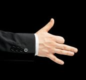 Caucasian male hand in a business suit isolated. Caucasian male hand in a business suit, showing the dog gesture sign, low-key lighting composition, isolated royalty free stock photo