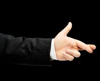 Caucasian male hand in a business suit isolated. Caucasian male hand in a business suit, showing the two crossed fingers for luck gesture sign, low-key lighting Royalty Free Stock Image