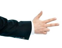 Caucasian male hand composition isolated. Dressed in a business suit caucasian male hand gesture, high-key light composition isolated over the white background Royalty Free Stock Photography