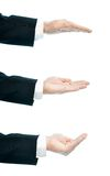 Caucasian male hand composition isolated. Dressed in a business suit caucasian male hand gesture of an opened palm, high-key light composition isolated over the Royalty Free Stock Photography
