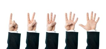Caucasian male hand composition isolated. Dressed in a business suit caucasian male hand number gestures, set of images from one to five, high-key light Stock Photo
