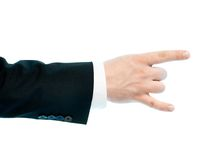 Caucasian male hand composition isolated. Dressed in a business suit caucasian male hand with the sign of horn gesture, high-key light composition isolated over Stock Photography
