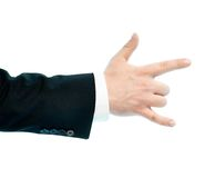 Caucasian male hand composition isolated. Dressed in a business suit caucasian male hand with the sign of horn gesture, high-key light composition isolated over Stock Image