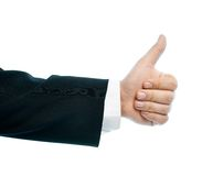 Caucasian male hand composition isolated. Dressed in a business suit caucasian male hand thumbs-up gesture, high-key light composition isolated over the white stock photography
