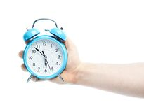 Caucasian male hand holding alarm clock Royalty Free Stock Photography