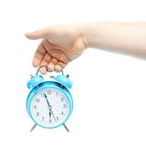Caucasian male hand holding alarm clock Stock Photos