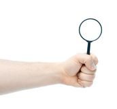 Caucasian male hand holding magnifying glass Stock Images