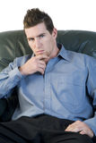 Caucasian male holding his chin stock image