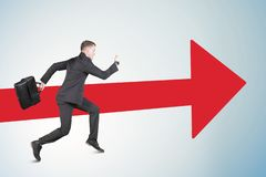 Caucasian male manager sprints with red arrow stock photos