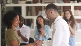 Caucasian male manager teacher handshake praise happy african female employee. Caucasian manager teacher handshake praise happy african employee student stock footage