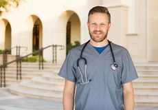 Caucasian Male Nurse In Front Of Hospital Building. Caucasian Male Nurse In Front Of a Hospital Building stock photos