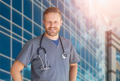 Caucasian Male Nurse In Front Of Hospital Building. Caucasian Male Nurse In Front Of a Hospital Building stock photography