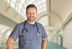 Caucasian Male Nurse Inside Hospital Building. Caucasian Male Nurse Inside a Hospital Building stock photos