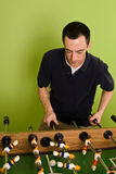 Caucasian male playing Foosball, table football Stock Image