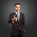 Caucasian male shows well done. Caucasian male businessman shows well done standing on different backgrounds Royalty Free Stock Photo