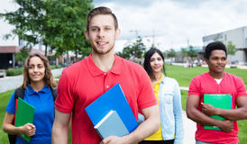 Caucasian male student with stubble and multiethnic friends Stock Images