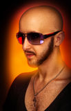 Caucasian male in sunglasses looking away in studio Royalty Free Stock Photo