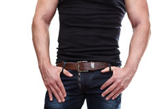 Caucasian male torso and arms on jeans Stock Photo