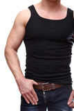 Caucasian male torso and arms on jeans Stock Photography