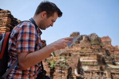 Caucasian male tourist with map in asia thailand. Travel lifestyle concept Royalty Free Stock Images
