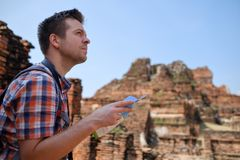 Caucasian male tourist with map in asia thailand. Travel lifestyle concept Stock Image