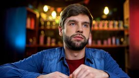 Caucasian male unhappy with favorite team missing goal, watching game in bar. Stock photo stock image