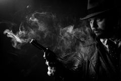 Caucasian Male in vintage trench coat and fedora. Black and white S. Caucasian Male in vintage trench coat and fedora. Black and white Royalty Free Stock Photos
